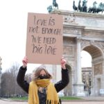 Cartello Love Is Not Enough, We Need Big Love a Milano